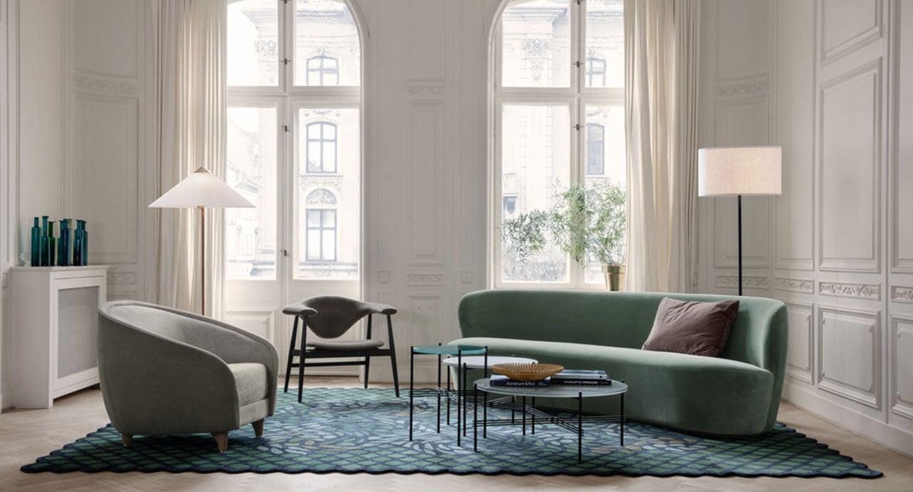 living con finestre poltrone divano tappeto